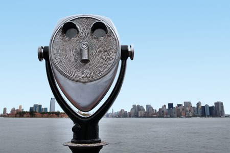 staten: Coin-Operated Binoculars against the  skyline of Manhattan New York from Statue of liberty Island, USA. Stock Photo