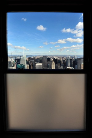 empire state: A window with an aerial view of skyscrapers in Manhattan from the Empire State Building in Manhattan, New York. Stock Photo