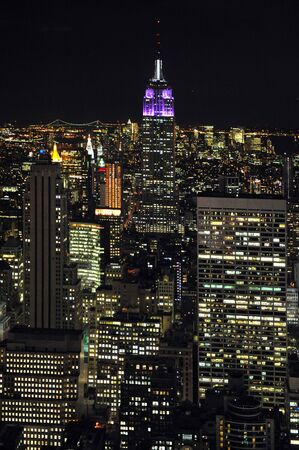 empire state building: An aerial view of the Empire State Building at night in Manhattan, New York. Stock Photo