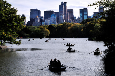 dingy: People raws on a dingy boat on the lake of Central Park Manhattan New York, USA.
