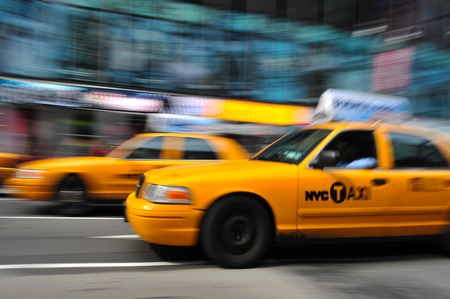 taxicabs: Blurry abstract photo of taxi cabs in Manhattan, New York in motion.