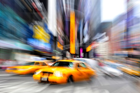 Blurry abstract photo of taxi cabs in Manhattan, New York in motion.