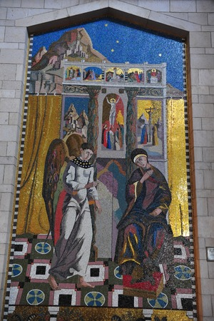 annunciation of mary: A wall painting of Gabriel the Angel and Mary at the Basilica of the Annunciation in Nazareth, Israel.
