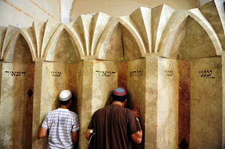 "Jewish men pray at the tomb of Rabbi Meir Baal Haness, Israel. Rabbi Meir's nickname, Baal Haness, means ""miracle worker"", which is why his tomb became a special place to pray for healing or other divine intervention. Editorial"
