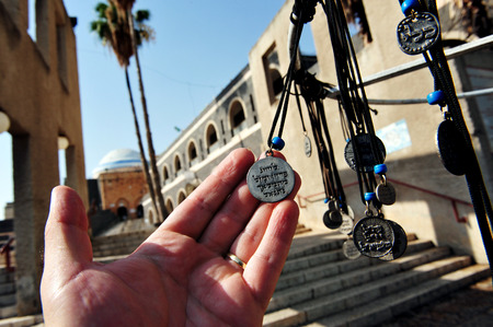 "Necklaces for sale at the tomb of Rabbi Meir Baal Haness, Israel. Rabbi Meir's nickname, Baal Haness, means ""miracle worker"", which is why his tomb became a special place to pray for healing or other divine intervention. Stock Photo"
