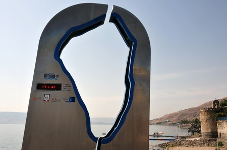depth measurement: A water level measurement instrument with the shape of the sea of Galellie in Teberia, Israel.