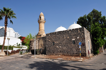 bazalt: An historic minaret, on a Muslim mosque in Tiberias on the sea of Galilee, Israel.