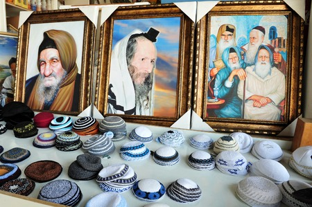 healers: Paintings of holy people and yarmulkes (Jewish head coverings) for sale at Maimonides tomb, located in central Tiberias, northern Israel. Maimonides tomb has become one of the most important Jewish pilgrimage sites in Israel. Editorial