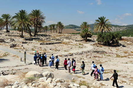 theological: MEGIDO - AUGUST 16:Visitors in Tel Megiddo an historical, geographical, and theological ruins site on August 16 2009 between the Carmel Ridge and the Jezreel Valley in the Western Galilee, Israel. Stock Photo