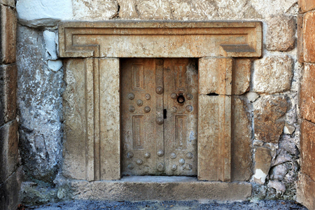 shearim: A very small door to ancient jewish tomb in Beit Shearim, israel.