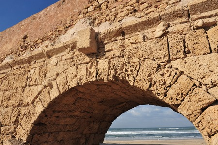 Ancient Roman aqueduct at Ceasarea along the coast of the Mediterranean Sea, Israel. photo
