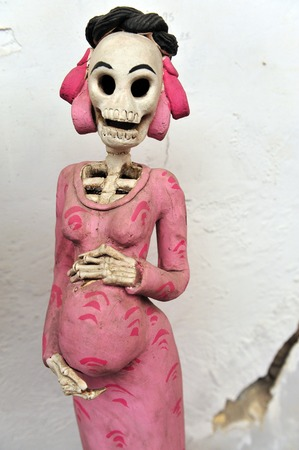 mexican folklore: Mexican folklore skeleton of pregnent woman for sale at  the Art-market of San Angel in Mexico City, Mexico.