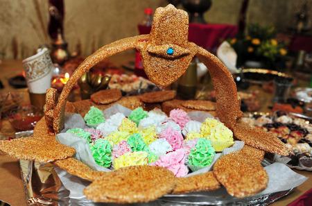 santa cena: Celebrando la fiesta tradicional de los jud�os del norte de �frica Mimouna celebr� el d�a despu�s de la fiesta jud�a de la Pascua. Foto de archivo
