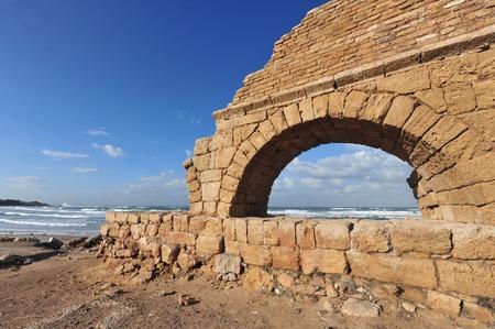 ceasarea: Ancient Roman aqueduct at Ceasarea along the coast of the Mediterranean Sea Israel Stock Photo