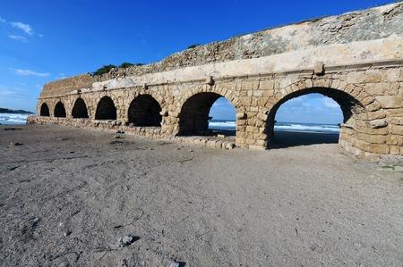 The roman aqueduct in ancient Caesarea Israel photo