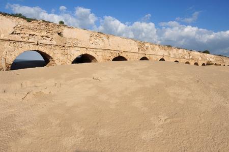 ceasarea: Ancient Roman aqueduct at Ceasarea along the coast of the Mediterranean Sea, Israel.