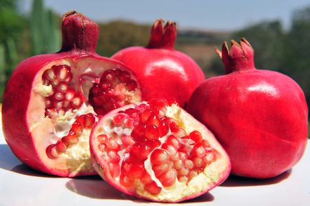 pips: Pomegranate fruit with pips in an outdoor setting - Jewish new year symbols