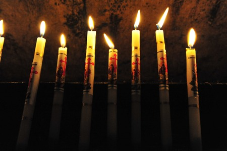 sepulcher: Candles at the Church of the Holy Sepulcher in the Jerusalem old city. Stock Photo