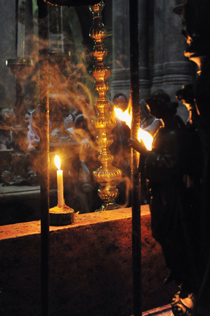 sepulchre: Candles at the Church of the Holy Sepulcher in the Jerusalem old city. Stock Photo