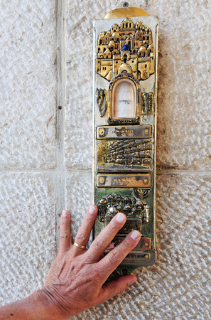 mezuzah: A giant Mezuzah on a doorway in the Jerusalem old city, Israel. Stock Photo