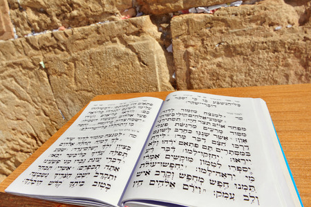 kotel: Torah book against the Kotel Wailing Western Wall empty at night in Jerusalem, Israel.