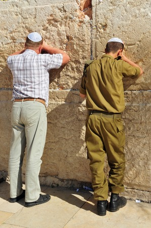 tora: JERUSALEM - NOVEMBER 05 : Jewish Men are praying at the western wall on November 05 2010 in Jerusalem, Israel.It is a remnant of the ancient wall that surrounded the Jewish Temples and is the most sacred site recognized by the Jewish faith outside of the Editorial