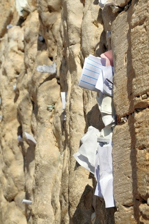 kotel: JERUSALEM - NOVEMBER 05: Notes to God at the Kotel Wailing Western Wall on November in Jerusalem, Israel.It is a remnant of the ancient wall that surrounded the Jewish Temples and is the most sacred site recognized by the Jewish faith outside of the Temp Editorial