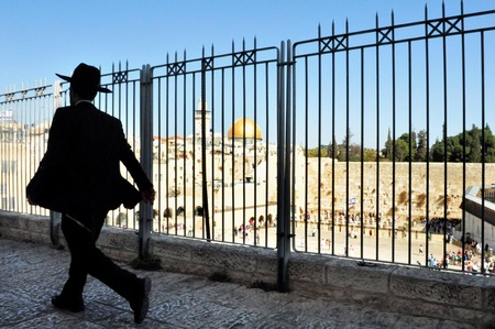 kotel: A Jewish orthodox man passing by the Kotel Wailing Western Wall in Jerusalem, Israel.