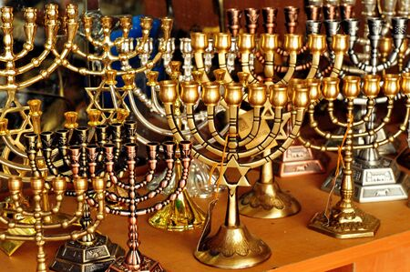 observed: Menorah for sale in shop in the Jerusalem old city market. Hanukkah Jewish holiday is observed for eight nights and days.