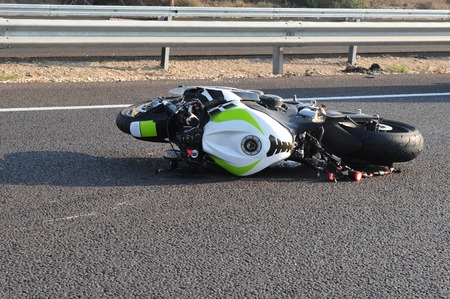 motorcycle officer: Motorbike accident on a main highway Stock Photo