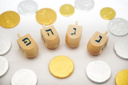 gelt: Hanukkah items: Wooden Dreidels and Chanukah gelt (Coins).