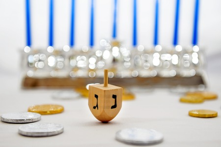 hanuka: Photo of a dreidel (spinning top), gelts (candy coins) and a silver menorah for Hanukkah, isolated on white