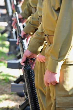 jewish group: Soldiers in uniform line up with guns