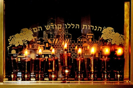 chanukiah: Candles on a menorah for the Jewish holiday Hanukkah that is observed for eight nights and days.