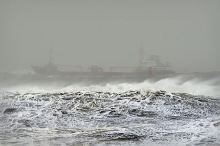 bad weather: A ship in the ocean during stormy weather