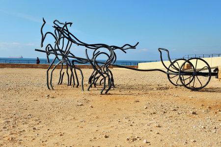 caesarea: CAESAREA - JANUARY 11: Sculpture of horse chariot at Caesarea National park on January 11 2011 in Caesarea, Israel. Editorial