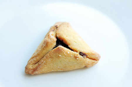 oznei: A Hamantaschen cookies pastry is Ashkenazi Jewish cuisine, traditionally eaten during the Jewish holiday of Purim.