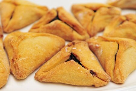 ashkenazi: A hamantash is a pastry in Ashkenazi Jewish cuisine, traditionally eaten during the Jewish holiday of Purim. Stock Photo