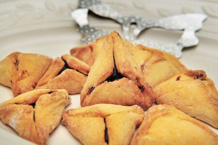 hamantash: A hamantash is a pastry in Ashkenazi Jewish cuisine, traditionally eaten during the Jewish holiday of Purim. Stock Photo