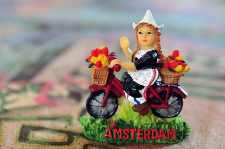 typical dutch souvenir of a Dutch girl on a table of a cafe  restaurant the city Amsterdam, Netherlands. photo