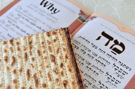 seider: Traditional Jewish Matzo sheets on a Passover Seder table. Passover is a Jewish holiday festival. It commemorates the Exodus from Egypt, in which the ancient Israelites were freed from slavery. Stock Photo