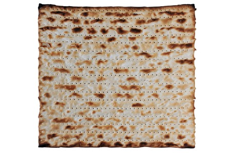 Traditional Jewish Matzo sheet on a Passover Seder table. Passover  is a predominantly Jewish holy day and festival. It commemorates the story of the Exodus, in which the ancient Israelites were freed from slavery in Egypt. Passover begins on the 15th day Stock Photo