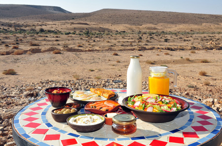 lodging: Traditional Israeli breakfast in Zimmers and country lodging in the Negev Desert. Stock Photo