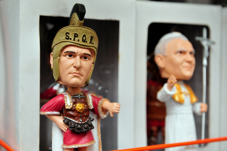 legionary: Souvenirs and small sculptures shop in Rome of a Roman legionary in ancient armour and the Pope in Rome, Italy.