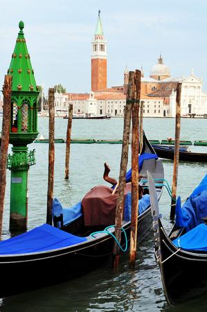 The Island of San Giorgio Maggiore with Venetian Gondolas in the foreground in Venice Italy photo