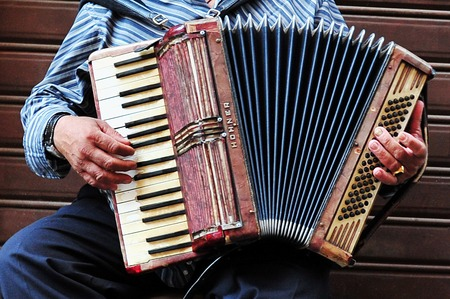 Musician plays accordion in Rome Italy
