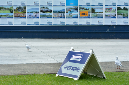 exceeding: AUCKLAND, NZL - FEB 25 2015:Harcourts Open Home.Harcourts International Ltd is the largest real estate group in New Zealand, exceeding a record $22 billion in sales for the 2013 financial year.