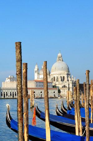 Campo della Salute church with Venetian Gondolas in the foreground in Venice, Italy.