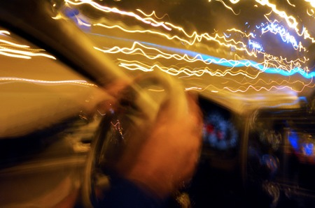 Drunk driver inside car driving at night. Concept photo 스톡 콘텐츠