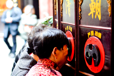 SHANGHAI, CN - MAR 15 2015:Chinese people watching Chinese Shadow Puppetry show in Shanghai, China.The art of Chinese Shadow Puppetry dated back over 2000 years ago.